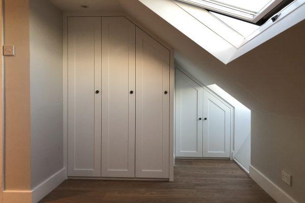 54. Angled loft storage wardrobes